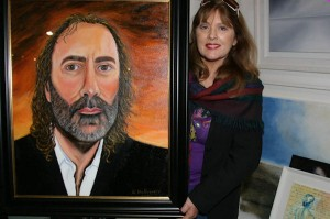 Nuala Halloway with portrait of John Waters
