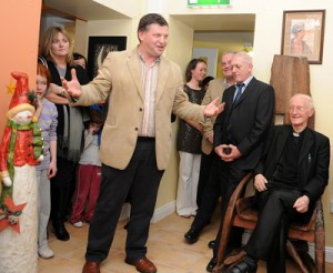 John O'Mahony opening the building, Bishop Flynn (seated right) who blessed the building
