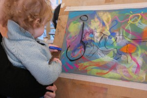Two year old Nova participating in the painting demonstration