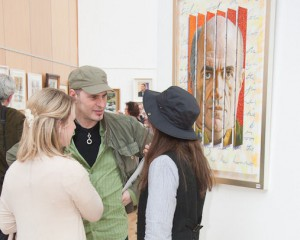 At the exhibition opening with a painting of Irish writer Colm T?ibín by artist Aidan Hickey in the background