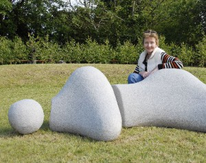 "Ann McGill next to her piece ""Reclining Figure"""