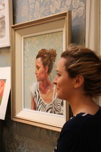 Gallery director Maria Corbett with her portrait by Kieran Crowley