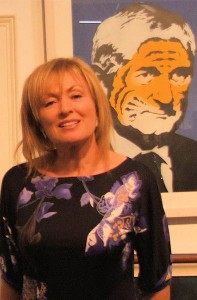 RTE Presenter, Mary Kennedy with a portrait of Bertie by graffiti artist, ADW at the Balla Bn Gallery Stand