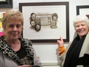 Artist Pervaneh Matthews and Lucy Behan with one of Pervaneh's Dubliners paintings