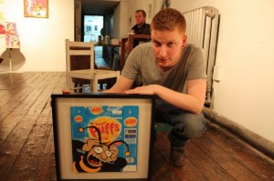 Artist Chris Cunningham with his completed art work