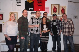 """Curator Alexa MacDermot with the artists at the opening of """"Food Fight"""""""