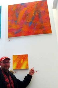 John pointing to the space where the painting hung