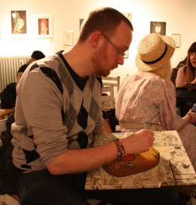 Artist Matthew Knight at work at the exhibition opening