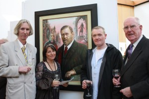 Curator Tony Strickland, artist Kate Bedell, artist Brian Gallagher and Aidan Doyle in front of a portrait of Bram Stoker by Aidan Hickey (photo Liam Madden)