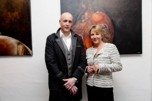 Artist Tony O'Connor with broadcaster Tracy Piggott at the exhibition opening