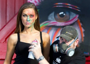 Model Rozanna Purcell with street artist Fink at Art Source 2012 Launch