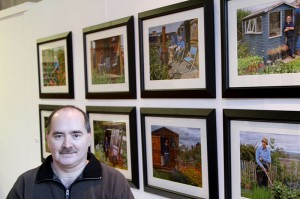 "Stephen Gill with a selection of his images from the ""Around the Allotments"" exhibition"