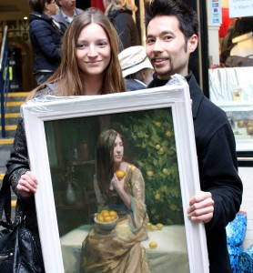 "Artist Ray Tsang with Alyssa Rohan who modeled for this oil painting on canvas entitled ""The Lemon Tree"""