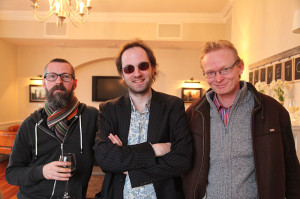 Artist Oisin Roche (centre) with his brother and Frank O'Dea of the Balla Ban Gallery (photo Liam Madden)
