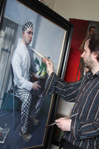Oisin with his painting of a Polish chef (photo Liam Madden)