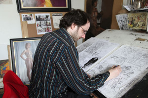 Oisin Roche with work on his graphic novel (photo Liam Madden)