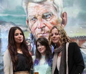 Claire-Michelle O'Connor, Aisling Kennedy and Clare Shanahan at the exhibition opening with Samuel Beckett in the background (photo Liam Madden)