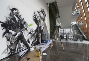 Fin Dac working on a U2 themed mural in the hotel
