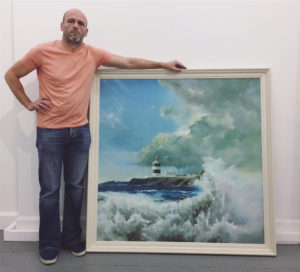 Alan Ryan with one of his paintings